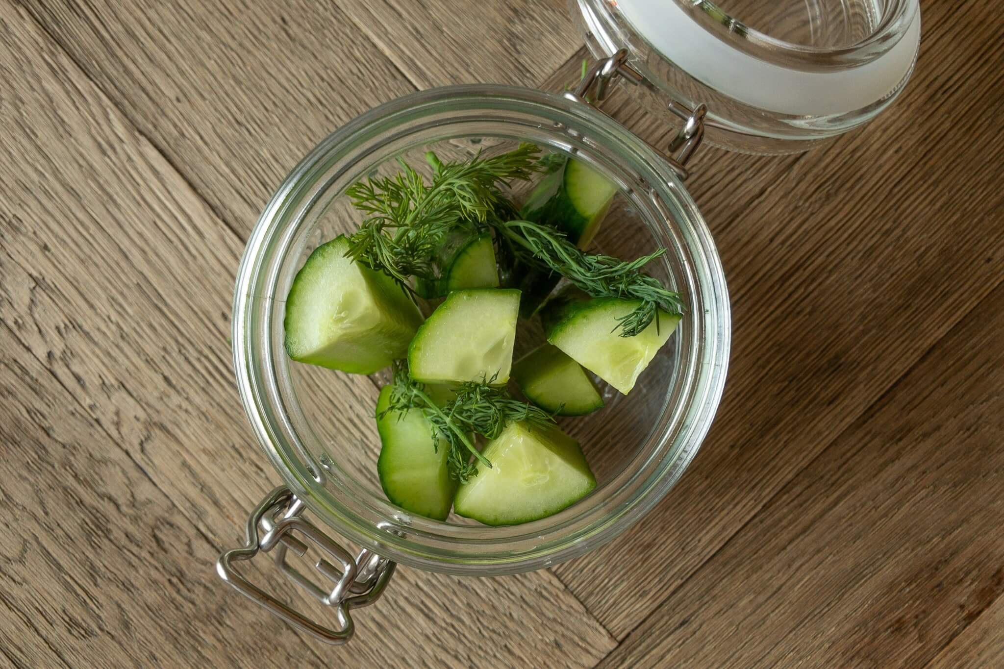Fresh cucumbers and dill in a jar