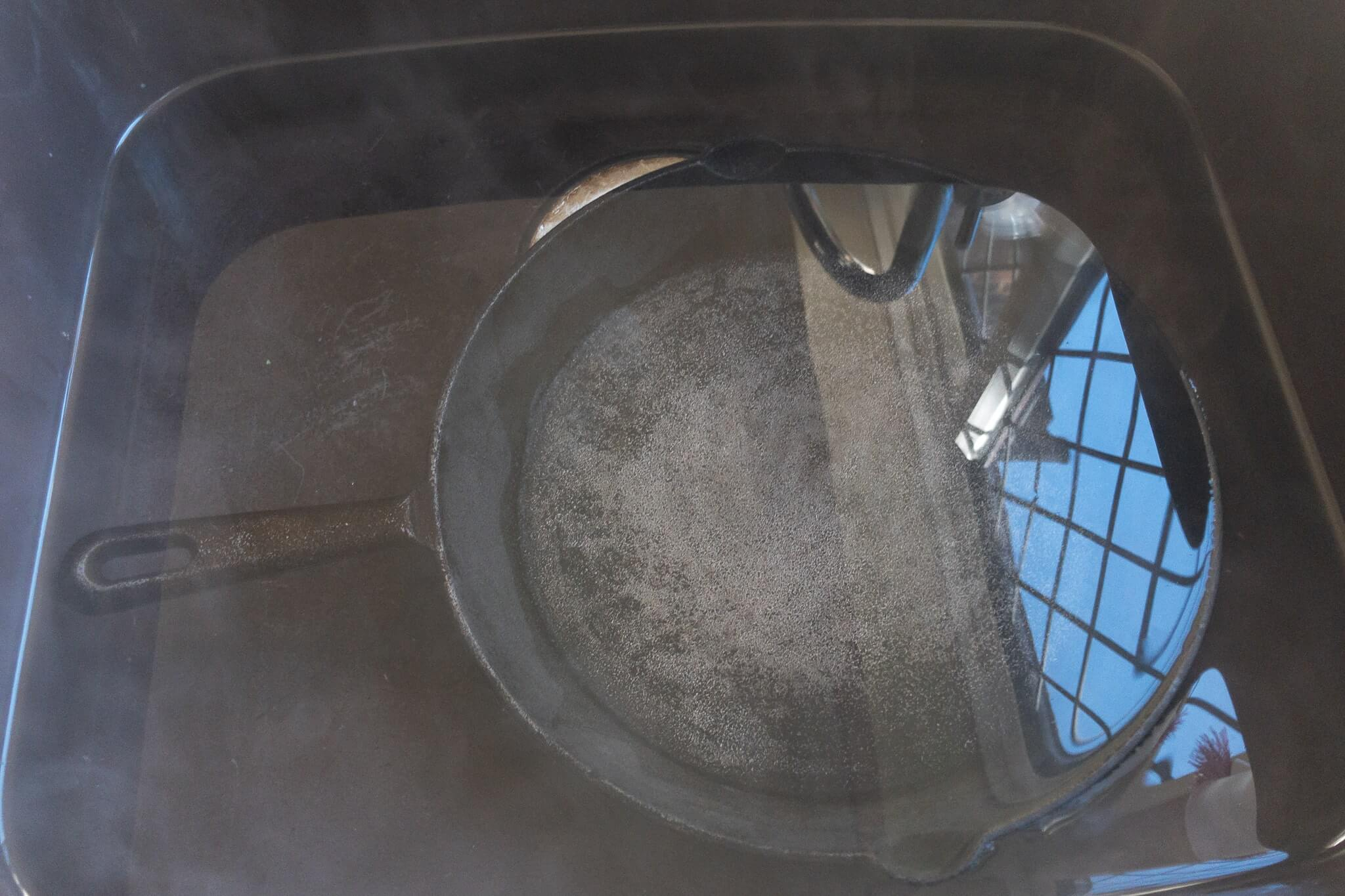 Cast iron soaking in boiling water and vinegar