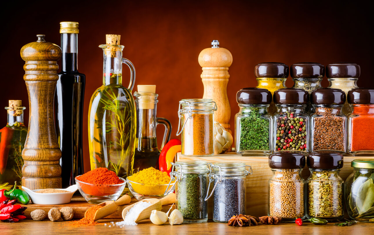 A range of oils, vinegar, herbs, and spices