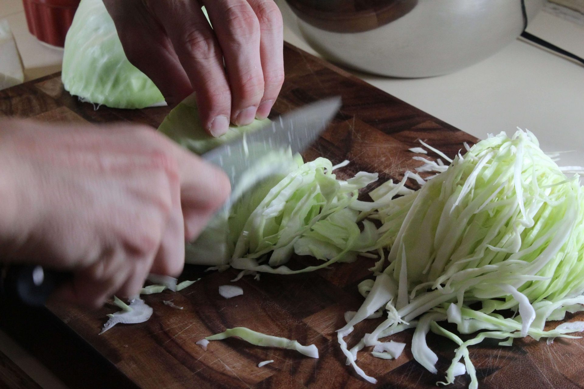 Chopping fresh cabbage to ferment