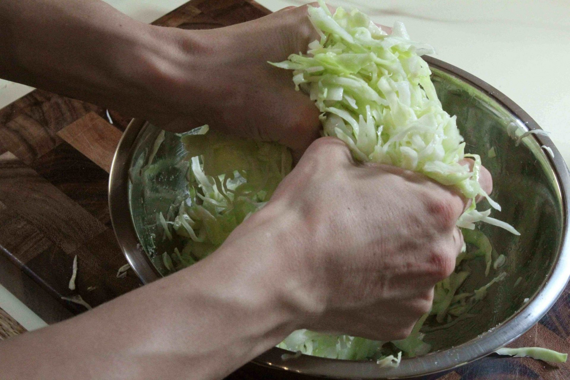 Squeezing liquid out of salted cabbage