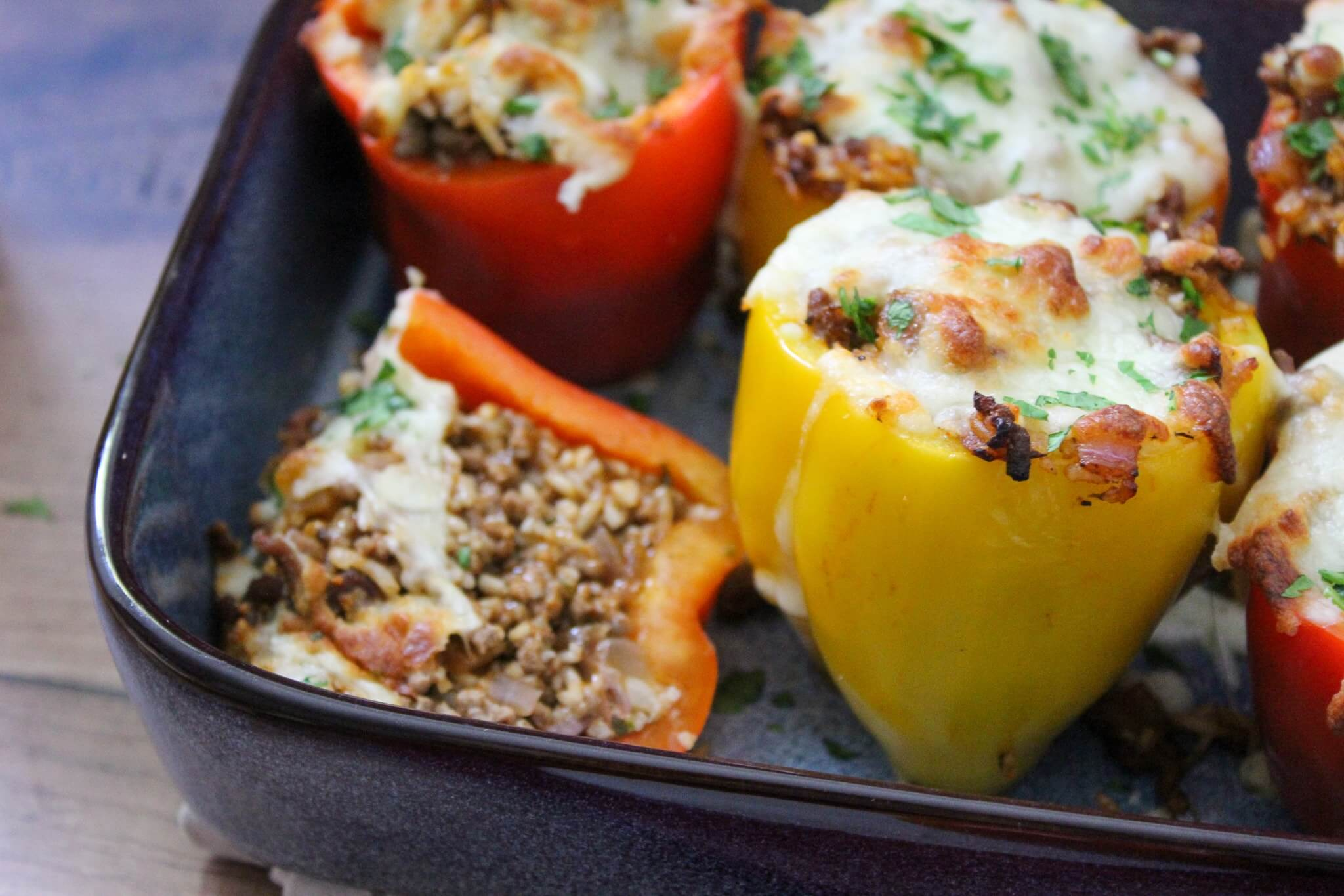 A stuffed pepper cut in half to reveal the meat and rice filling